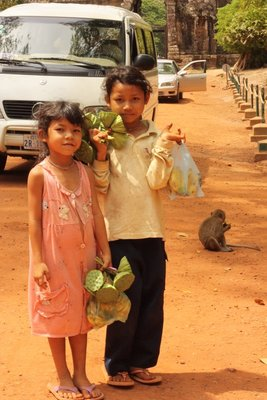 A couple of girls selling lotus root for the monkeys