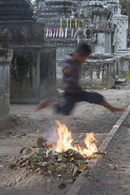Before leaving the monastery, we spotted a local kid who thought it was fun to jump over a pile of burning trash and leaves.  I wish I had changed the settings on the camera to get him frozen in the air, rather than as a blur.  Either way, it's obvious that he's jumping