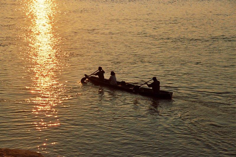 sailing the amazon river at sunset