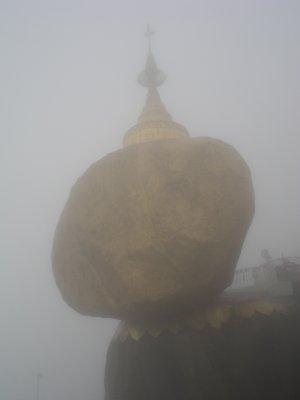 Mist envelopes the Golden Rock