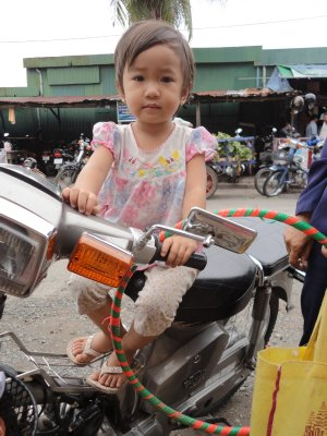 They start young riding scooters in this part of the world!