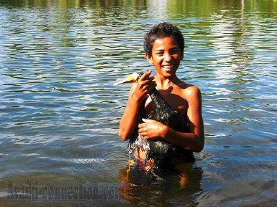 Boy with bird- Lake Tegano