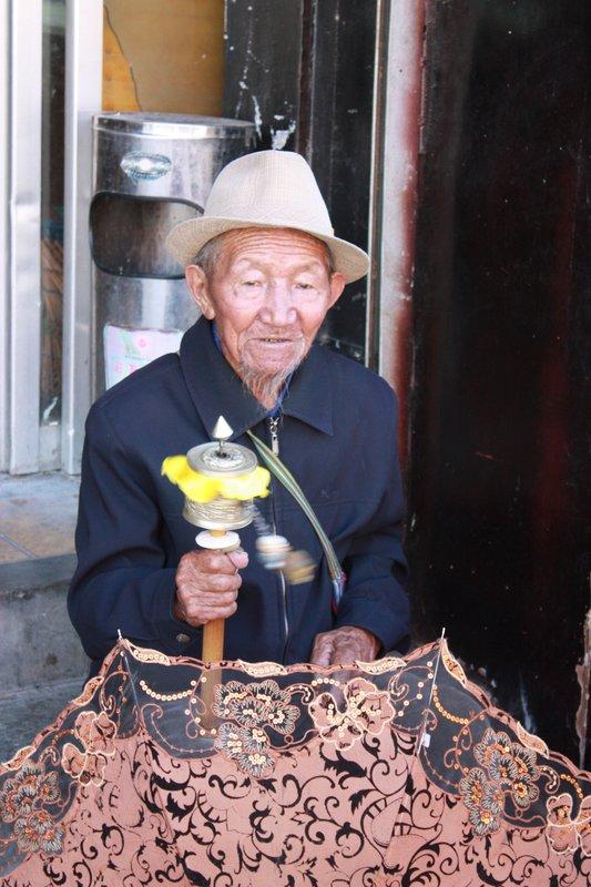 Prayer wheels and umbrellas, Lhasa, Tibet