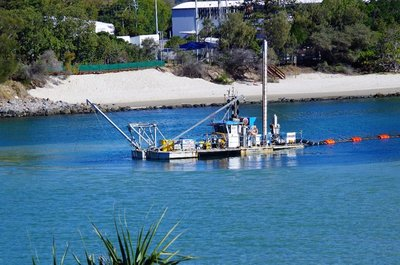 Tallebudgera Creek dredge re-positioning in the creek.