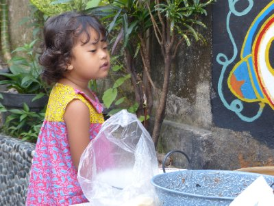 Neighbor girl talking with with Miss Gudeg