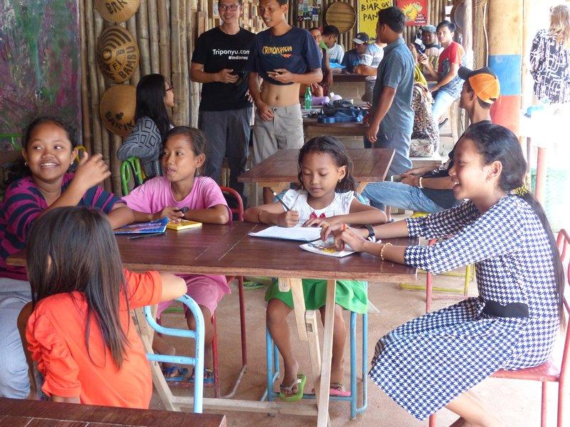 Village children enjoying their lesson
