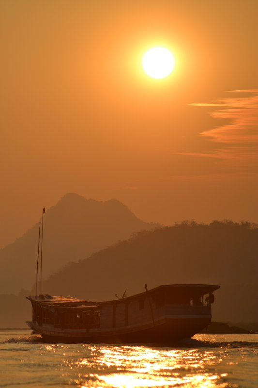 View from our slow boat on the Mekong in Laos - sunset