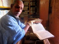 Librarian with his manuscripts