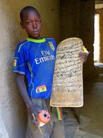 Boy Practicing Islamic Verses