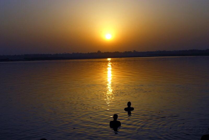 Prayers to Surya, the Sun God, River Ganges, Varanasi, India