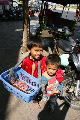 Two brothers selling bracelets