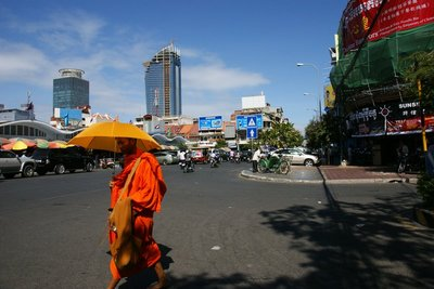 Phnom Penh with typical sight of orange clad monk