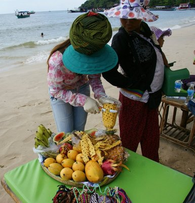 Buying fruit from a beach seller