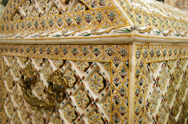 Intricate decoration of a camel-bone trunk near Mount Nebo's mosaic factory and outlet