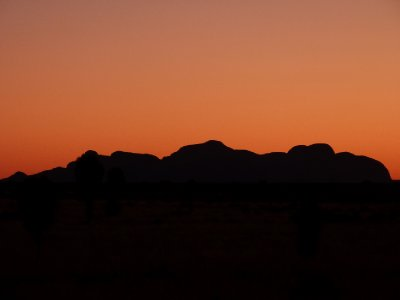 Sunset over the Olgas nr Ayers Rock - looks like Homer Simpson lying down ...