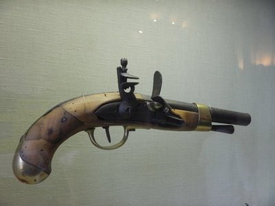 This 1813 pistol was among the many weapons displayed; the typical suits of armor, swords and guns kept the young boys attentive