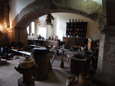 The Grand Kitchen measures 10 meters by 8 meters and is quartered by powerful stone arches; the castle was used in the movies George and the Dragon and Shadow of the Vampire