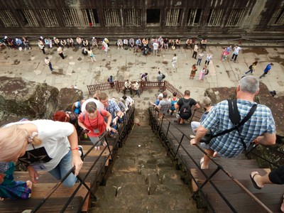 Even with the improved stairs for tourists, the steep incline is roughly 65 degrees to reach the top level of Angkor Wat; more than 400 sq kms is included in the UNESCO World Heritage Site here