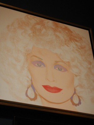 Dolly Parton, Andy Warhol, 1985; apparently Marilyn Monroe wasn't the only blonde bombshell Warhol painted; this piece was painted just 2 years before Warhol died at 58 following gallbladder surgery
