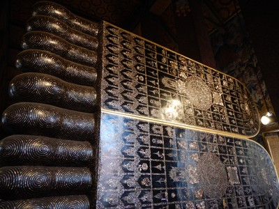 The feet of the 46 meter long reclining Buddha at Wat Pho are amazingly ornate featuring inlaid mother-of-pearl; Wat Pho is also known as the birthplace of traditional Thai massage which is still taught and practiced at the temple