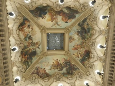 The ceiling above the grand staircase includes paintings The Triumph of Apollo and The Enchantment of Music Deploying its Charms