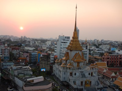 Wat Traimit at sunset from the roof of our hotel; the air pollution contributes to some sensational sunsets