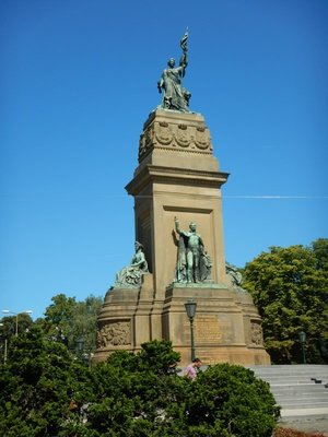The national memorial on Plein 1813 recalls the formation of the Kingdom of the Netherlands in 1813; bicyclists all use proper hand signals and have the right of way over cars and buses