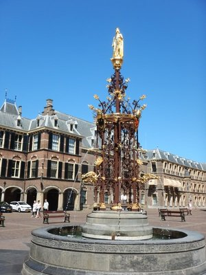 This golden fountain depicts retired Queen Beatrix, a reminder that the respectful Dutch parliamentarians govern with the monarch's symbolic approval
