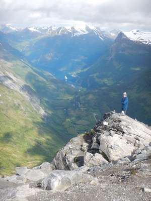 Lee admiring view 1500 meters above Geirangerfjord at Dalsnibba lookout