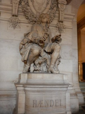 The grand vestibule has statues of 4 composers; there were separate entrances and seating areas for the rich and the poor
