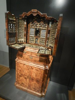 Collector's Cabinet with Miniature Apothecary 1730; housing dozens of small pots and bottles containing ingredients for medicines, this was like a mini-CVS contained in a single piece of furniture