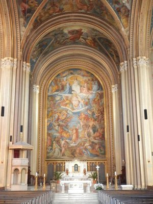 The Catholic Parish and University Church St. Louis, called Ludwigskirche, is a monumental church in neo-Romanesque style with the second-largest altar fresco in the world
