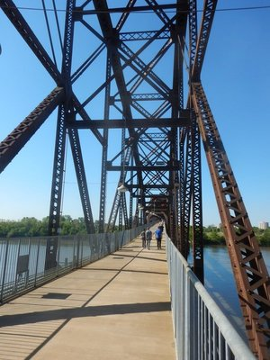 An old railroad bridge has been converted into a popular pedestrian bridge connecting North Little Rock to Little Rock right at the Clinton Library