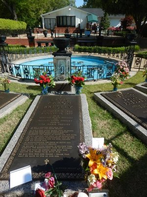 Elvis had a small meditation garden added; this is where he is buried along with his brother, his parents and his favorite grandmother