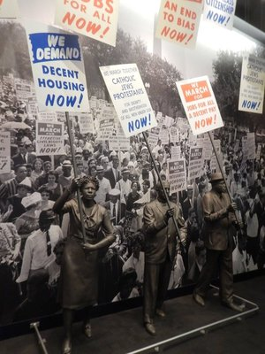 1963 was the centennial of the Emancipation Proclamation but Blacks still suffered high unemployment, systematic disenfranchisement and racial segregation