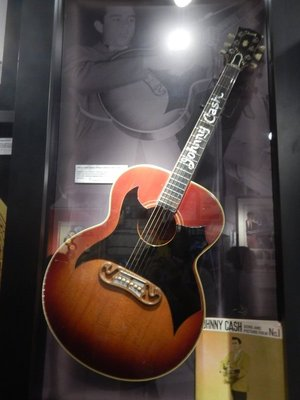 Gibson guitar made for Cash in 1959; Cash is the only entertainer in history to be inducted into the Country Music, Rock and Songwriter's Halls of Fame