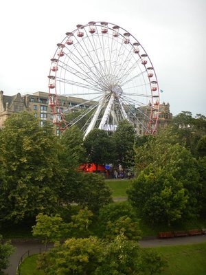 Ferris wheel located next to Princes Street Gardens with nice views of the castle