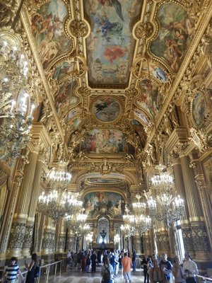 The Grand Foyer is made to seem even bigger through the play of mirrors and windows; Baudry painted the ceiling which features themes from the history of music