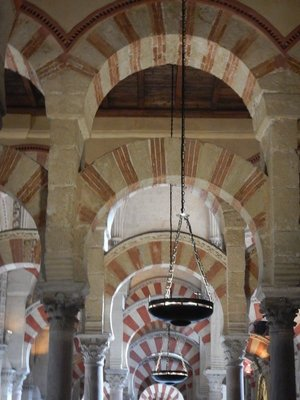 The Mezquita's most defining characteristic is its unique terracotta- and white-striped arches; since 1236, without missing a single day, mass has been held here