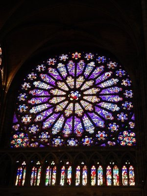 The north rose window is a stone structure 14  meters across, showing the Tree of Jesse, which supposedly served as a model for the one in Notre Dame