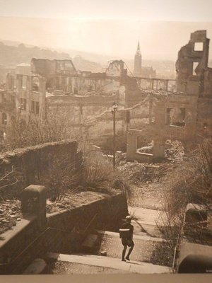 This somber photo shows a German child going to school in his bombed out city; the castle is closed on Mondays and in January and February