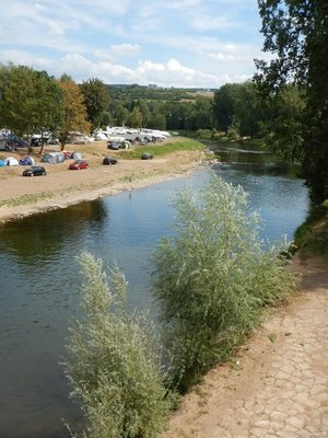 Lots of people camping on the German side as if they are waiting for their chance to enter Luxembourg; some people are walking/swimming in the Sure River but no one is crossing into Luxembourg
