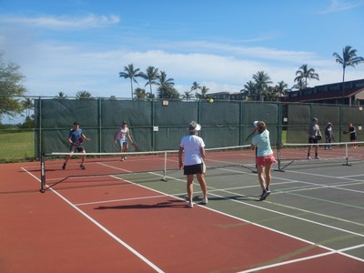When Ben tired of our pickle ball foursome we would drive into Kihei where people get together every day on the public courts for pick-up games; the crowd skewed older such as these two ladies schooling Ben and Lee