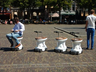 What an incredible innovation!; people were enjoying racing around on toilets modified as seated Segways (I think I'd add a toilet bowl so you'd have storage space)