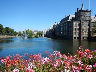 The castle-like Binnenhof complex, overlooking a giant pond, sits in the center of The Hague; visitors can walk freely through the complex with barely a glimpse of security