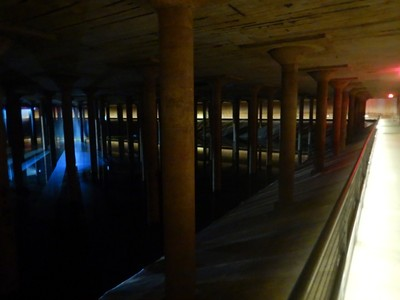 The Buffalo Bayou Park Cistern is a former drinking water reservoir built in 1926; it held 15 million gallons of water, is 87,500 sq ft and has 221 25-foot tall, slender concrete columns