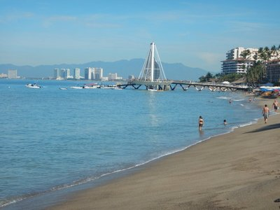 The modern pier at Playa de los Muertos, the city's largest public beach; PV is a popular retirement destination for Americans and Canadians