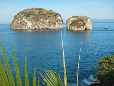 The water looks deceptively calm in this photo of Los Arcos; swimming out to the islands I experienced a very different view