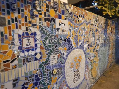 The main square is being decorated with beautiful tile murals; not a city where you would want to rent a car