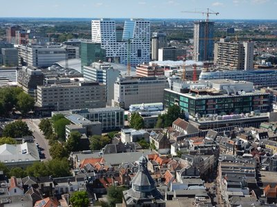 A modern skyline is developing around the train station; the white building is locally famous since it's in the shape of a U for Utrecht